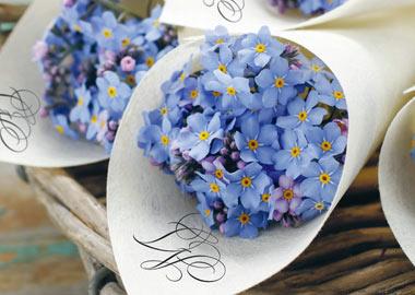 Lilla blomster i papir kræmmerhus