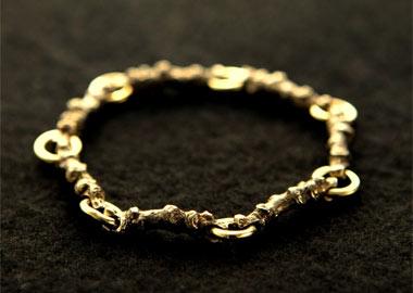 Armbånd i guld