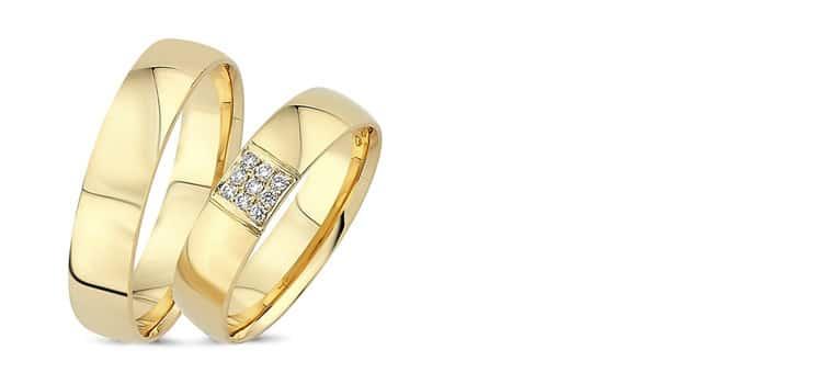 brede-vielsesringe-guld med sten i damering
