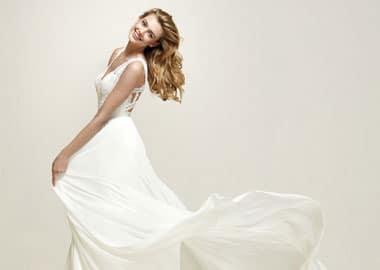 Brudekjole med stropper og masser af blonder