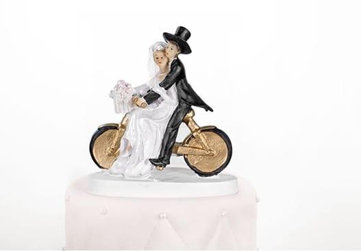 bryllupsfigur brud og gom på cykel