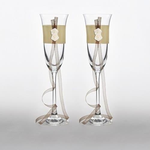 brudeparrets champagneglas med guldbånd og roser