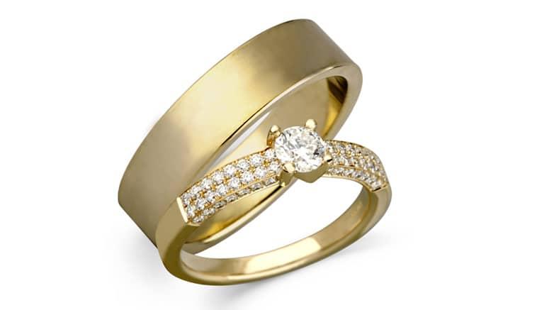 Vielsesringe i 14K guld med centerbrillant i dameringen