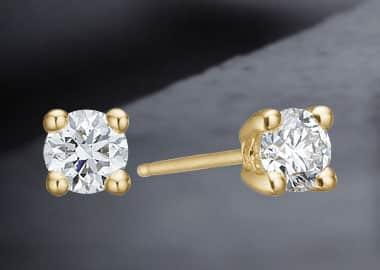 Ørestikkere i guld med diamant