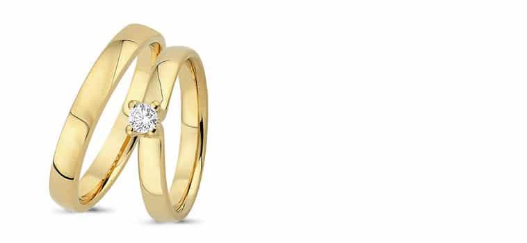 smalle guldringe-med-diamant i damering