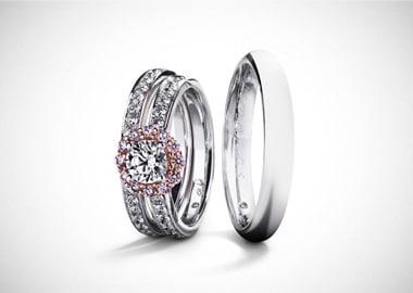 Vielsesringe i hvidguld mange diamanter i dameringen